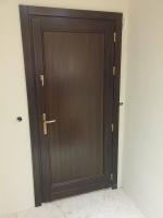 Fa bejárati ajtó telifa betétes