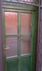 zöld fa bejárati ajtó